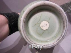 An antique Chinese celadon porcelain bottle vase, Ming dynasty
