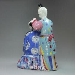 Chinese famille rose'ear-cleaning' figure group, Qianlong (1736-95)